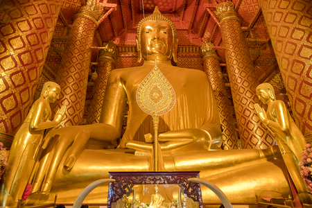 Giant golden Buddha in Wat Phanan Choeng Temple in Ayutthaya, Thailand