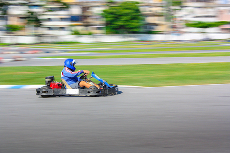 Go Kart Racer on track, Shot is panned to emphasize speed.