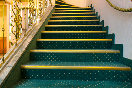 Interior stairs with green carpet - Majestic interior marble stairs.