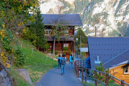 Beatenberg, Switzerland - Oct 18, 2018: Tourists are walking to the Beautiful view of alpine Eiger village, Switzerland