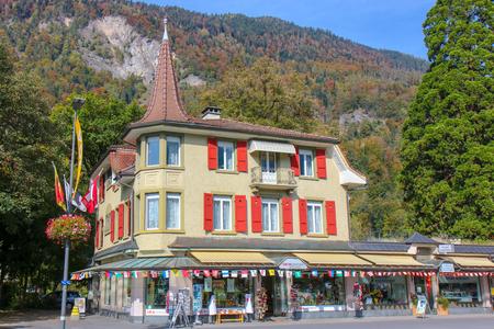 Interlaken, Switzerland - Oct 18 2018: Hoeheweg Boulevard with hotels, restaurants, shops. Interlaken is a popular resort town lying between beautiful lakes in Interlaken, Switzerland Redakční