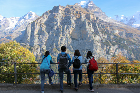 Zermatt, Switzerland - Oct 15, 2018 Young traveler on the holiday. Photographer with camera photoshooting Beautiful view of Swiss alps, Grindelwald , Switzerland Editorial