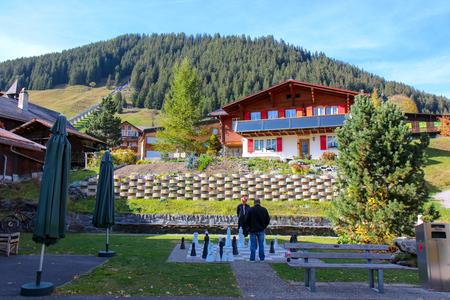 Interlaken, Switzerland - Oct 16 2018 : two man playing giant chess on playground, Switzerland
