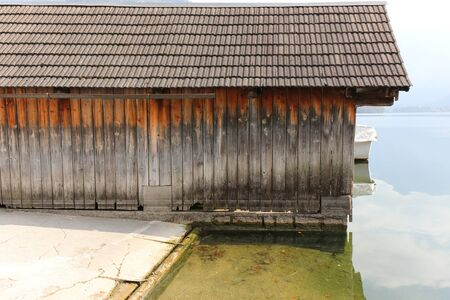 Pier of wooden planks, Boatshed on the River in house. Stock Photo