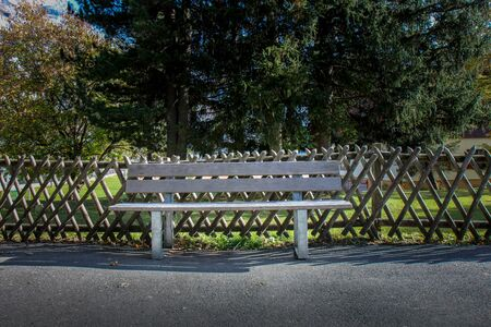 bench made of weathered wood in warm sunlight Фото со стока