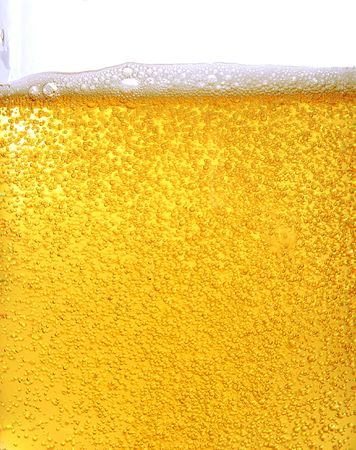 glass beer bottle: Beer and bubbles in bottle