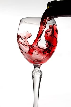 Red wine pouring into glass isolated on white background Stock Photo - 2192060