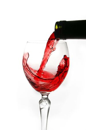 Red wine pouring into glass isolated on white background Stock Photo - 2192051
