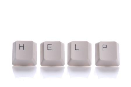 periferia: HELP scritto con i pulsanti della tastiera su sfondo bianco Archivio Fotografico