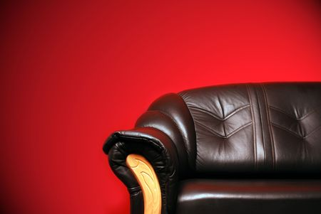 black sofa in front of a red wall Stock Photo - 6241931