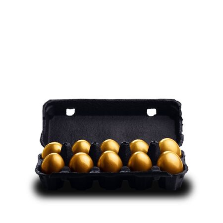 Gold eggs in a black carton isolated on white background