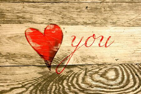 Heart on weathered wooden background photo