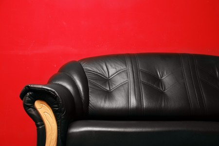 black sofa in front of a red wall Stock Photo - 7883969