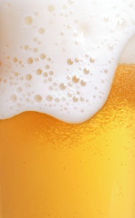 close up of beer with foam photo