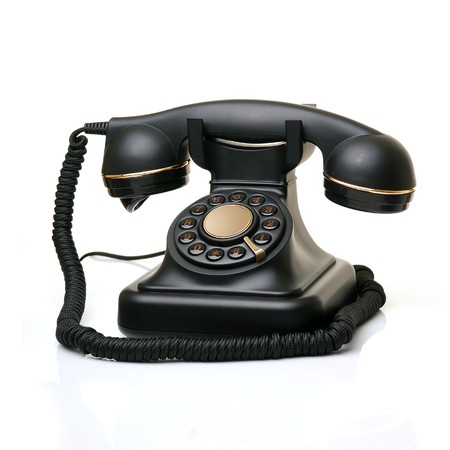 rotary phone: old vintage phone on white  Stock Photo