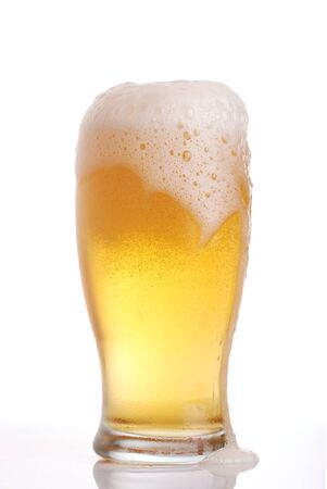 Glass of beer close-up with froth Stock Photo - 7883659