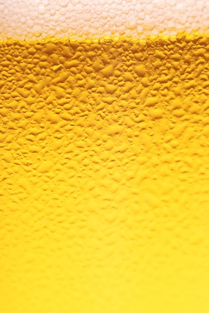 froth: Fresh beer dewy glass texture close-up