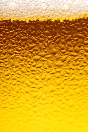 Fresh beer dewy glass texture close-up