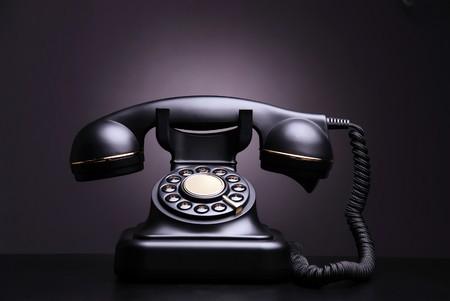 old technology: Vintage phone on dark background