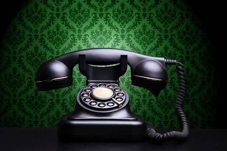 Vintage phone on dark background Stock Photo