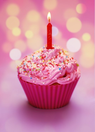 first birthday: Pink birthday cupcake with a candle Stock Photo