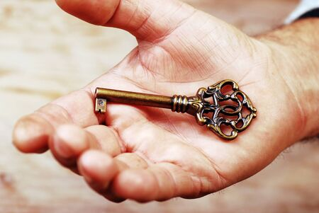 A key in a hand  Stock Photo