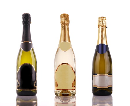 gold capped: Champagne bottles with blank labels Stock Photo