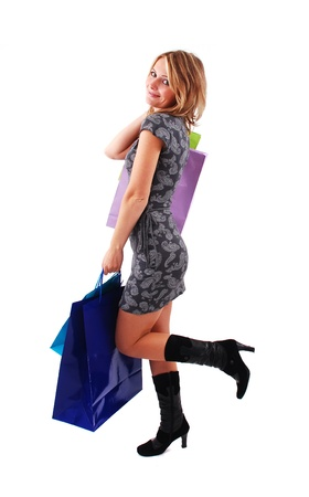 Sexy shopping girl isolated on white background Stock Photo - 9061514