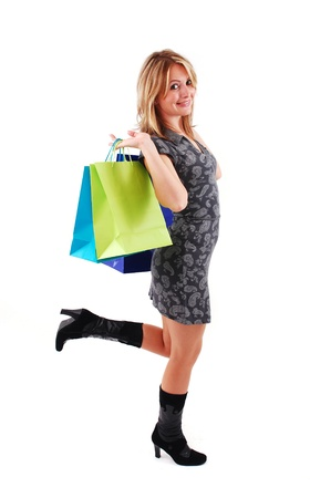 Sexy shopping girl isolated on white background Stock Photo - 9061489