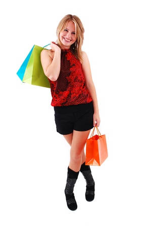Sexy shopping girl isolated on white background Stock Photo - 9061463