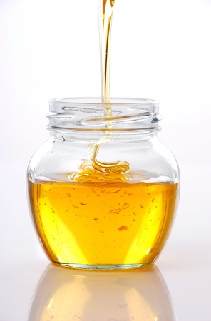 Jar of honey on white background  Stock Photo