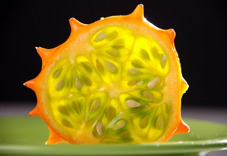 hedged: Kiwano or African horned melon . Also known as hedged gourd, African Horned Cucumber, English tomato  Stock Photo