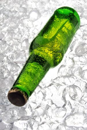 Green bottle of beer on ice Stock Photo - 14323213