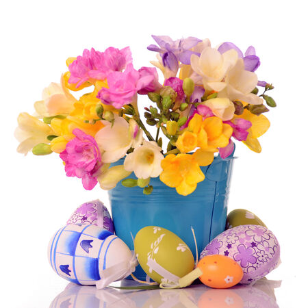 spring flowers with easter eggs photo
