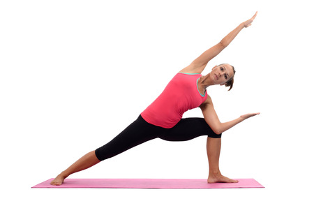 Young woman doing yoga exercises photo