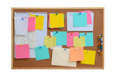 schedule reports: Blank, colourful notes pinned into brown corkboard