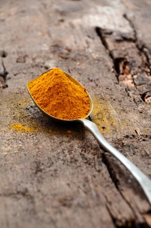 peppery: Ground turmeric in a spoon Stock Photo
