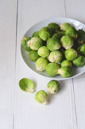 brussel: Fresh brussel sprouts on white wooden background