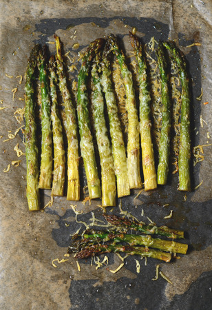 nutritiously: Oven roasted asparagus with olive oil in a pan Stock Photo