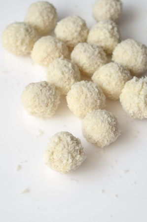 snowball: Coconut snowball white truffles on white background Stock Photo