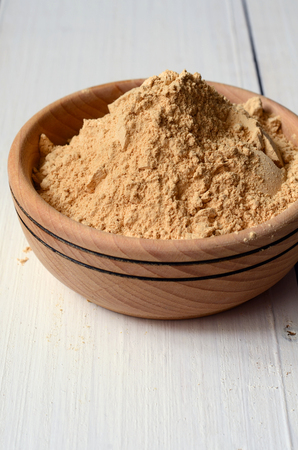aphrodisiac: Maca root powder in a wooden bowl