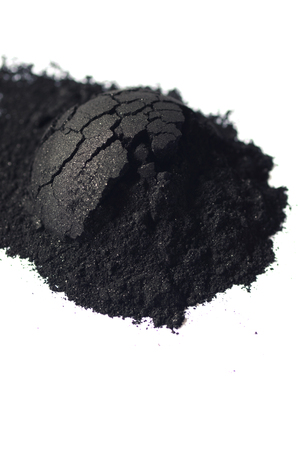 Activated charcoal powder shot with a macro lens Stock Photo
