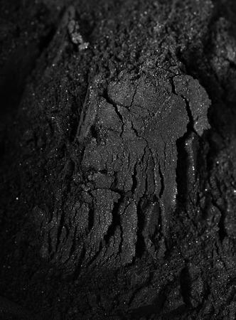 Activated charcoal powder shot with a macro lens Foto de archivo