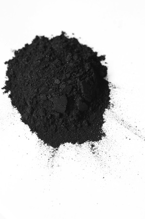 Activated charcoal powder shot with a macro lens Stockfoto
