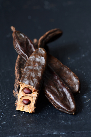 carob: Ripe carob pods, can be used as a substitute for cocoa