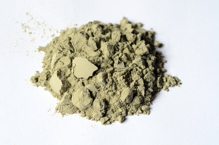 Green cosmetic clay powder close up image