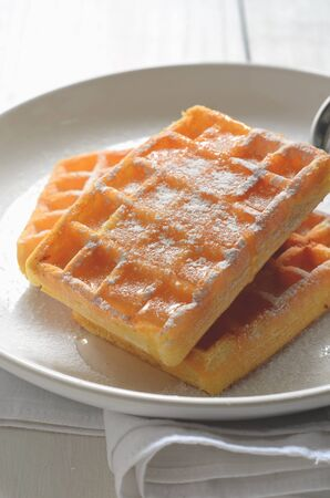 belgian: Traditional Belgian Waffles on a white plate