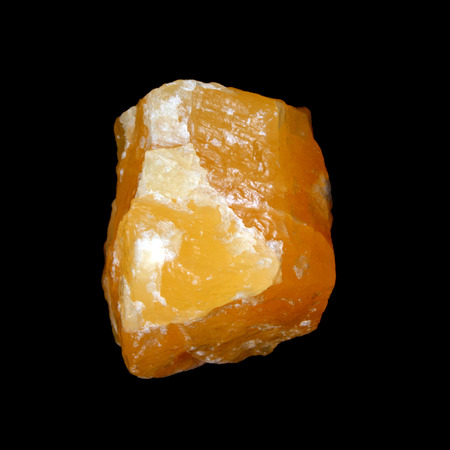 gemology: Raw Yellow calcite, isolated on black background Stock Photo