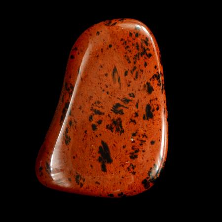 mahogany: Mahogany Obsidian gemstone, isolated on black background