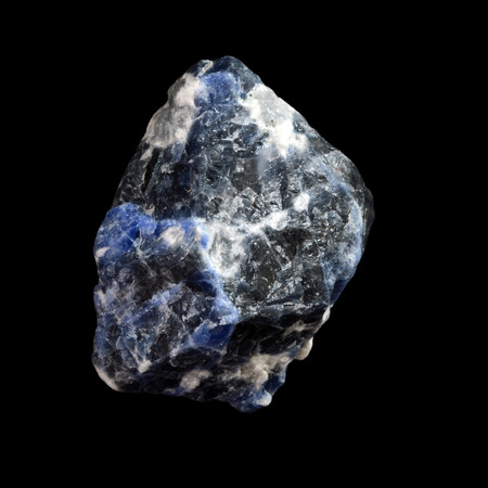 sodalite: raw sodalite stone,  isolated on black background Stock Photo